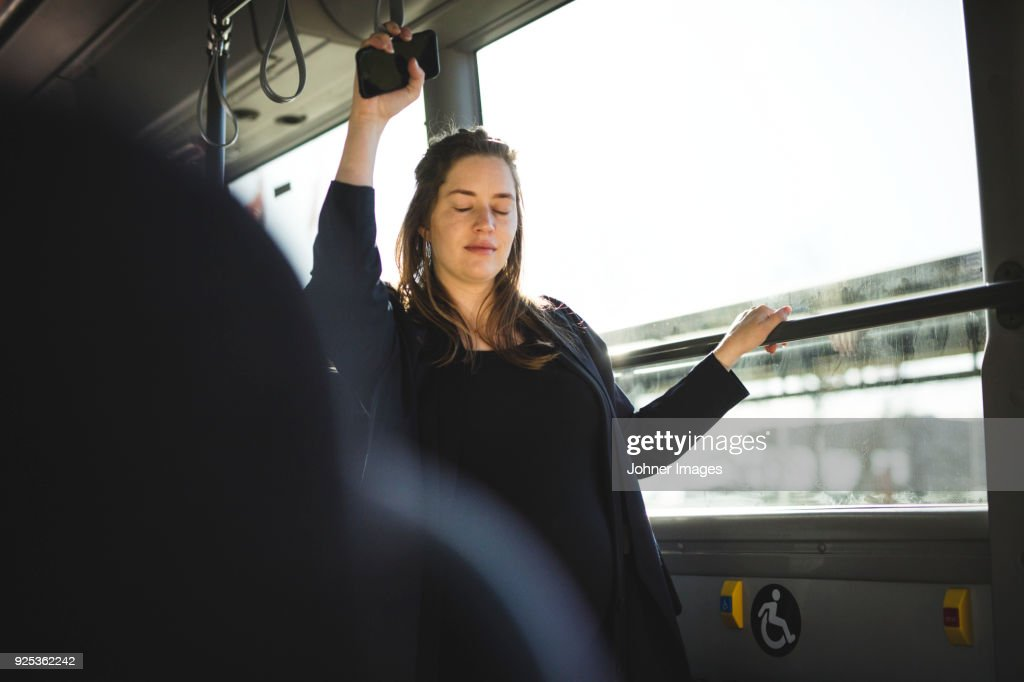 Pregnant woman traveling by bus : Stock Photo