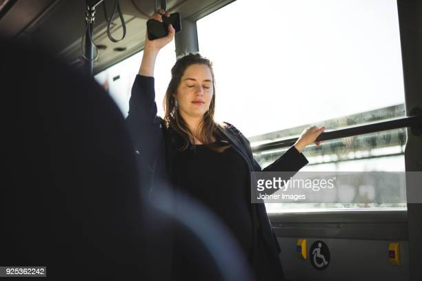 pregnant woman traveling by bus - public transport stock pictures, royalty-free photos & images