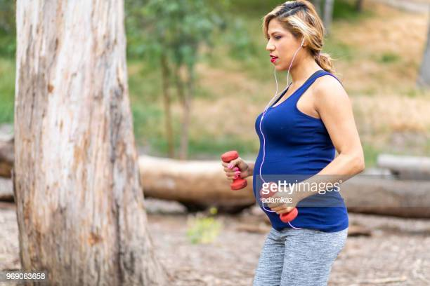 Pregnant Woman Walking with Weights