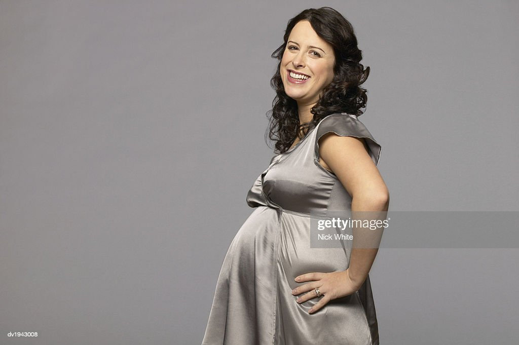 Pregnant woman Wearing a Grey Satin Night Dress : Stock Photo