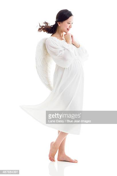 Pregnant woman wearing angel wings
