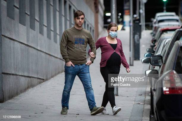 Pregnant woman wears face mask as the country works to stop the spread of the coronavirus on March 15, 2020 in Madrid, Spain. The cases in Madrid are...
