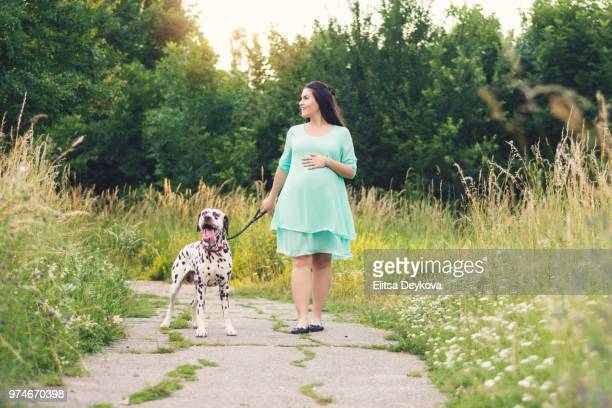 Pregnant woman with a dog