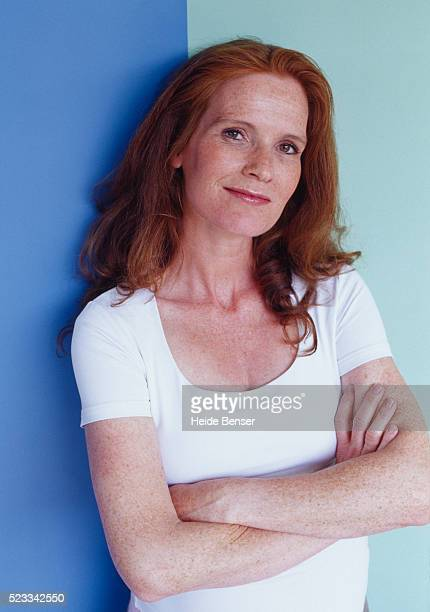 pregnant woman with arms crossed looking into the camera - older redhead stock pictures, royalty-free photos & images