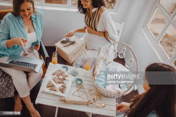 pregnant woman with her female friends - baby shower stock pictures, royalty-free photos & images