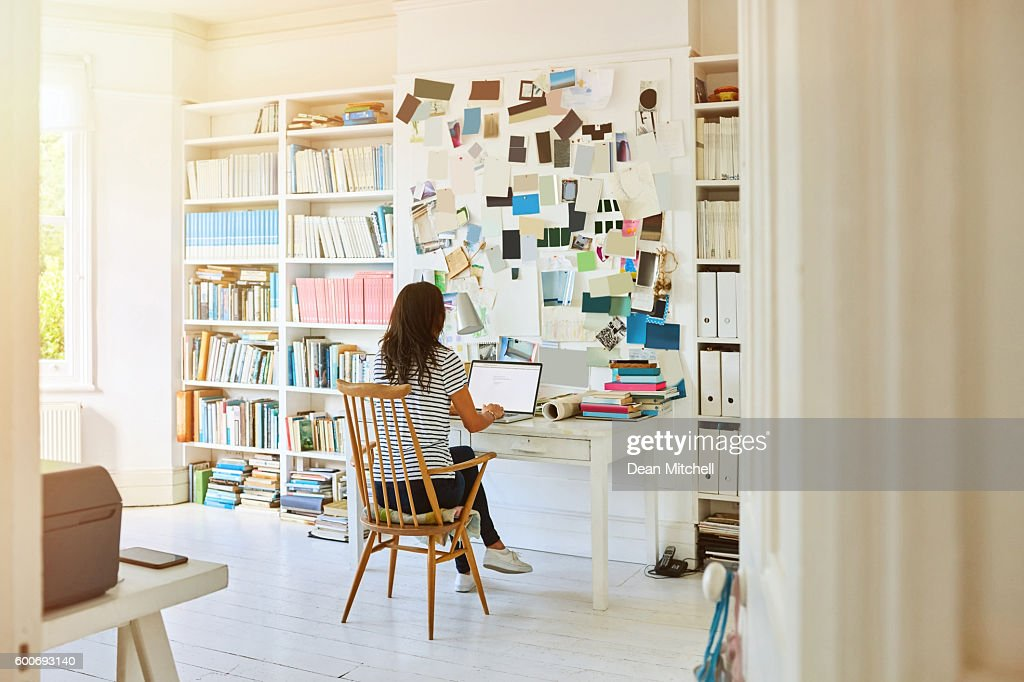 Pregnant woman working at home : Stock Photo
