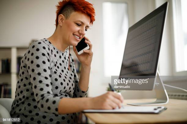 pregnant woman working from home office - form filling stock photos and pictures