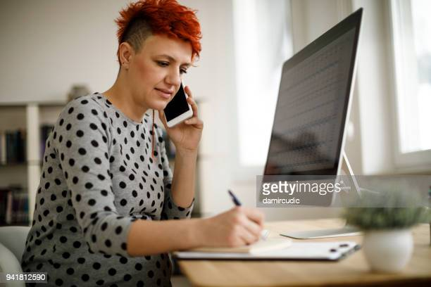 pregnant woman working from home office - health insurance stock pictures, royalty-free photos & images
