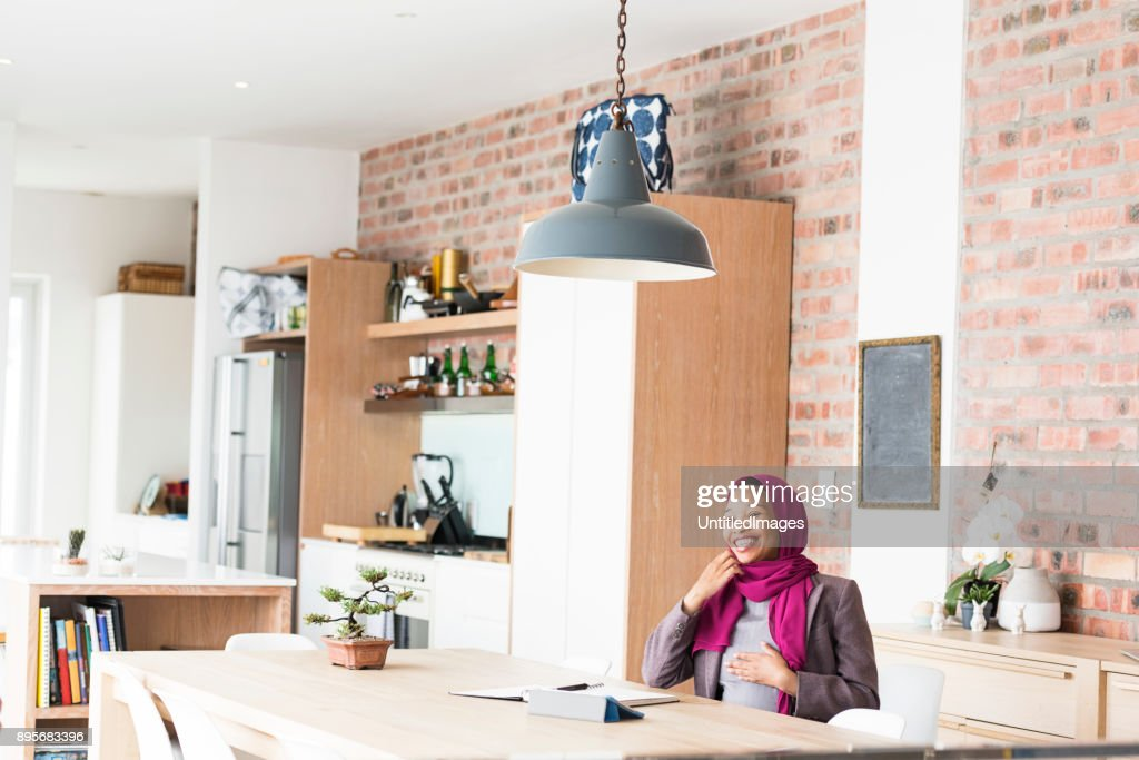 Pregnant woman working from home : Stock Photo