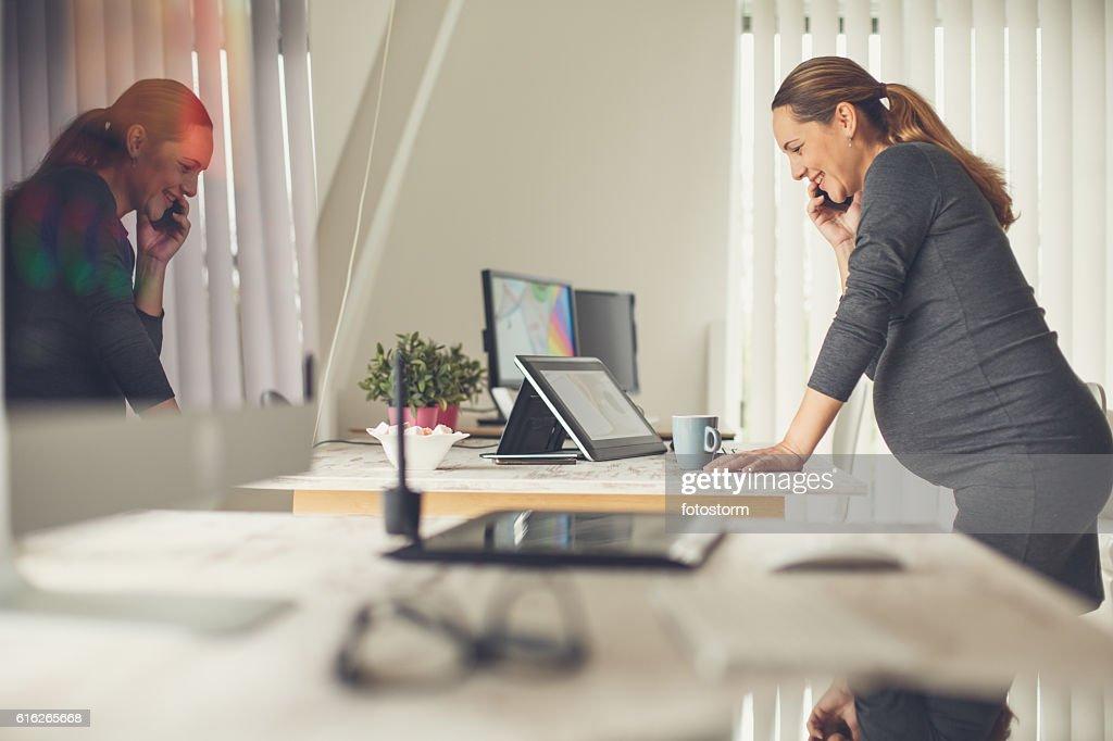 Pregnant woman working in graphic design studio : Stock Photo