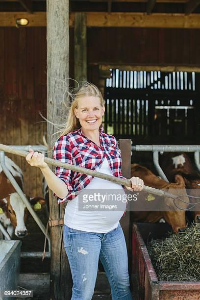 Pregnant woman working on farm