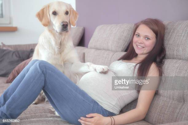 Pregnant women  and a dog