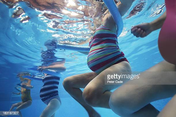 pregnant women exercising in pool - pregnancy stock pictures, royalty-free photos & images