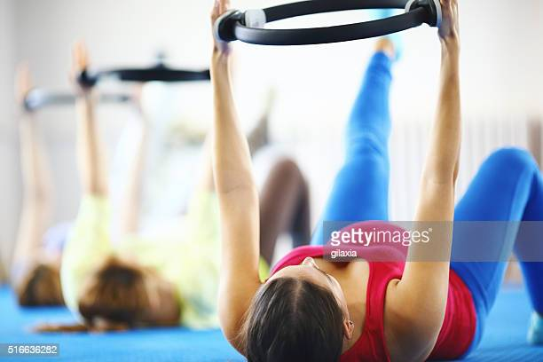 Pregnant women exercising.