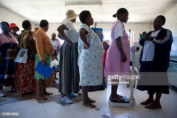 Pregnant women line up to be weighed by a community volunteer at an antenatal sessionin Thabana Morena clinic The group is given advice on nutrition...