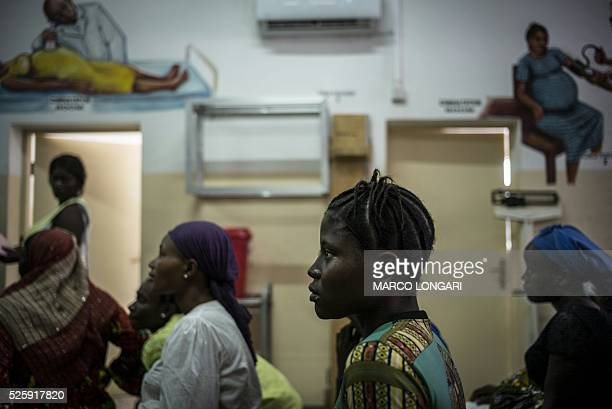 Pregnant women sit in the waiting area at the prenatal clinic of the Princess Christian Maternity Hospital in Freetown on April 25 2016 With the head...