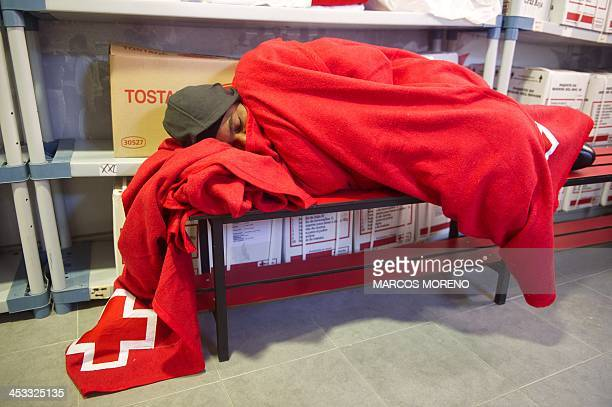 A pregnant wouldbe immigrant rests at the local of Spanish emergency services after being rescued off the Spanish coast and led to Tarifa on December...