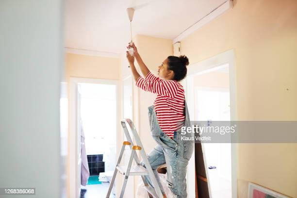 pregnant young woman renovating home - 家庭の備品 ストックフォトと画像