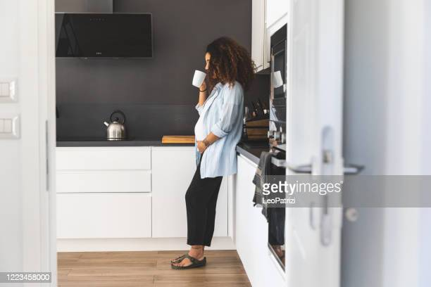 pregnant young woman with enjoying breakfast - avoidance stock pictures, royalty-free photos & images