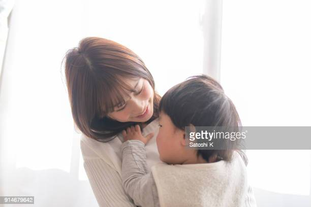 pregrant mother holding son - japanese mom stock photos and pictures