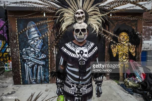 Prehispanic dancers take part in a Saint Death celebration at a sanctuary in Santa Maria Cuautepec Tultitlan Mexico on August 5 2018 People venerate...