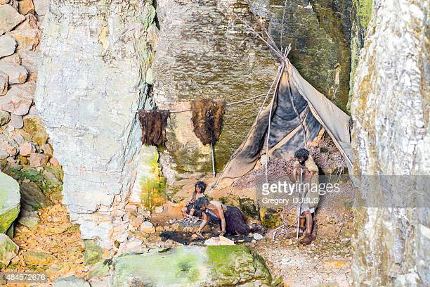 prehistoric caveman family camp in cave of la balme france - stone age stock photos and pictures