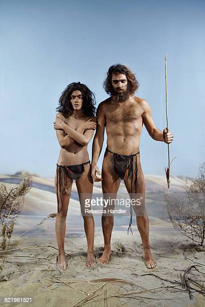 Prehistoric man and woman next to each other