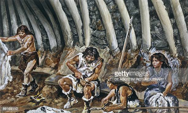 Prehistoric people in cave, illustration