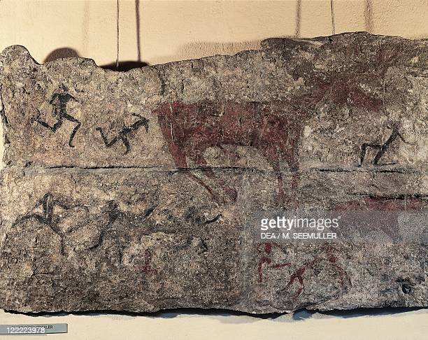Prehistory Turkey Neolithic Cave painting depicting a hunting scene From Catal Huyuk or Catalhoyuk sanctuary 7th millennium bC