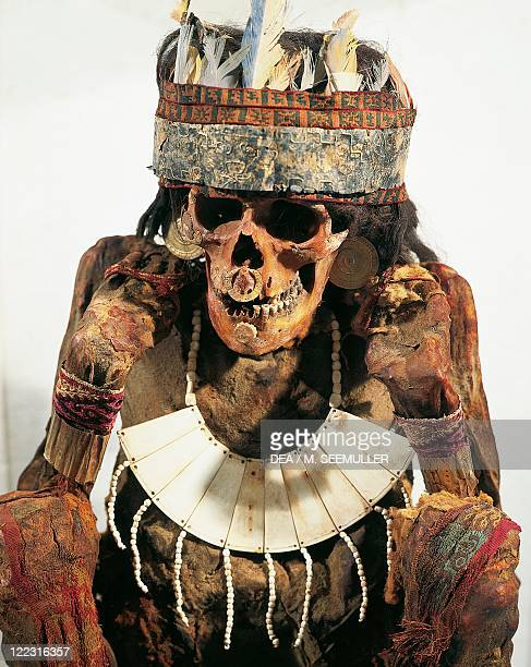 PreInca civilization Peru 3rd century bC Paracas culture Mummy of a woman of the Necropolis decorated with gold and bone jewels and a feather...