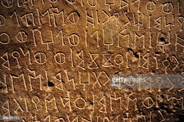 PreIslam Funerary stele with an Old South Arabian inscription Late 1st millennium BC Limestone 60x48x13 cm Qaryat alFaw National Museum Riyadh Saudi...