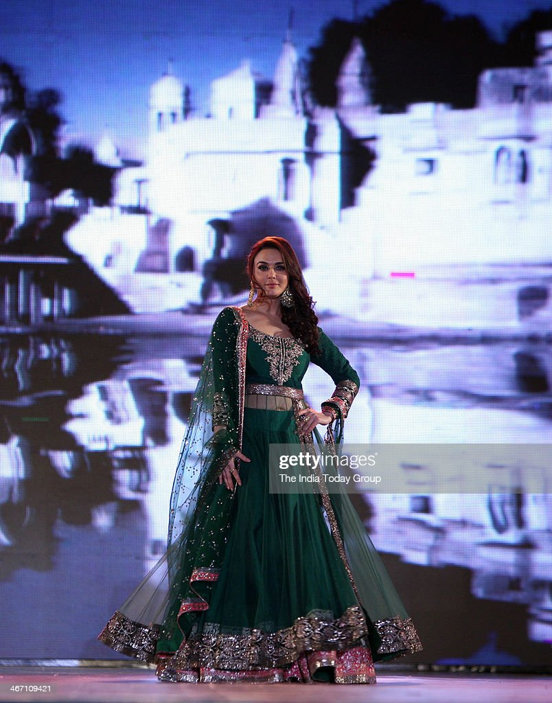 Preity Zinta displays an outfit by Indian designer Manish Malhotra during a fashion show to support the cause of saving and empowering the female...
