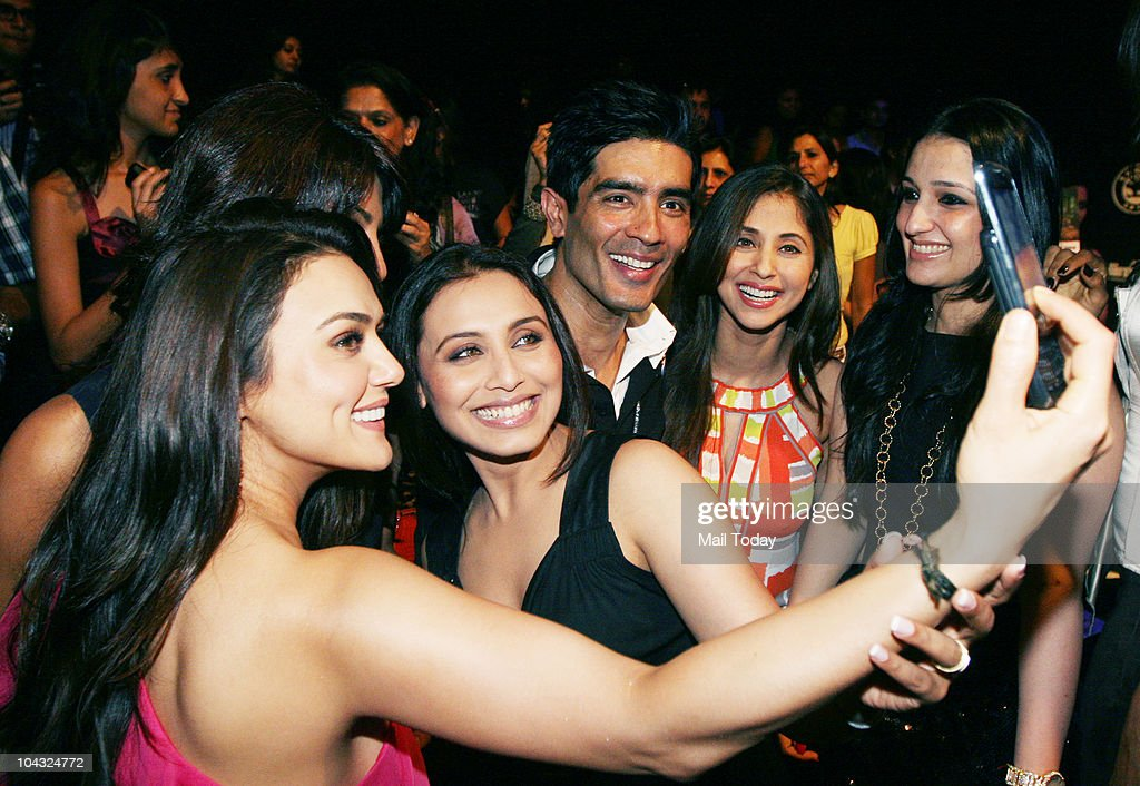Preity Zinta Priyanka Chopra and Rani Mukherjee click pictures as Manish Malhotra and Urmila Matondkar look on at designer Manish Malhotra`s show on..