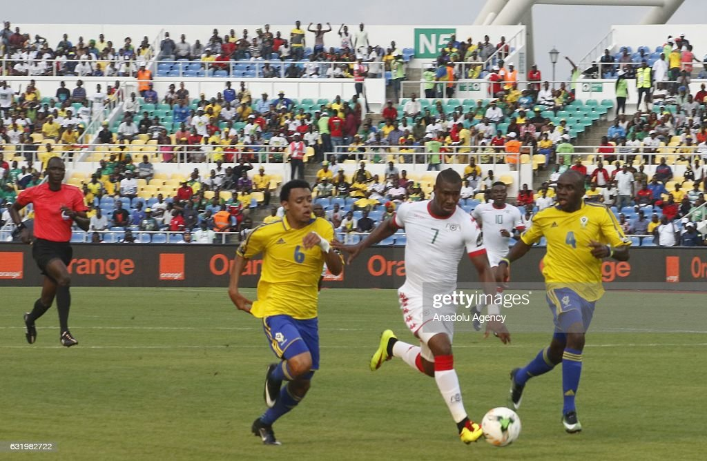 Prejuce Nakoulma (C) of Burkina Faso runs for the ball against Johann Obiang (L) and Merlin Tandjigora (R) of Gabon during the 2017 Africa Cup of Nations group A football match between Gabon and Burkina Faso at the Stade d'Angondje in Libreville, Gabon on January 18, 2017.