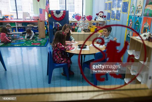 PreK students are seen through a door with the school logo on it At the St Andrews Episcopal School in Potomac MD they use brain research to inform...