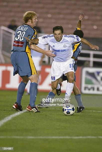 bc0f75fe734 Preki of the Kansas City Wizards squeezes past Alexi Lalas and Mauricio  Cienfuegos of the Los