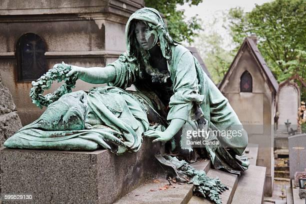 Père-Lachaise cemetery, sculpture in grave, Paris (France)