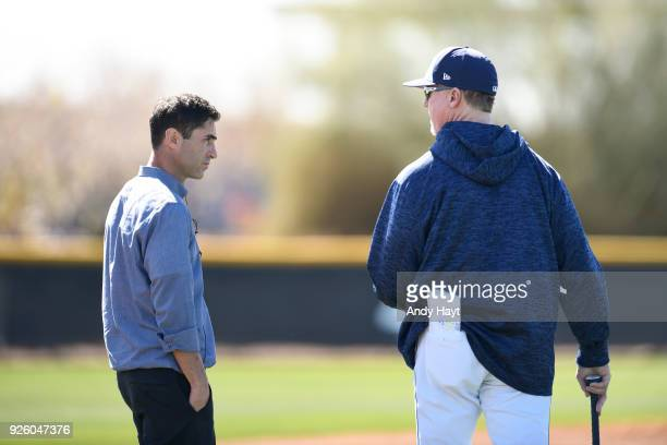 Preller and Mark McGwire of the San Diego Padres talk during a workout at the Peoria Sports Complex on February 21 2018 in Peoria Arizona