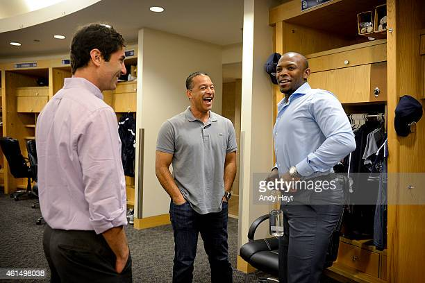 Preller Dave Roberts and Justin Upton of the San Diego Padres visit in the clubhouse prior to a press conference introducing Justin Upton to the...