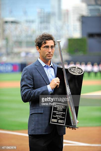 J Preller general manager of the San Diego Padres holds the Louisville Slugger Silver Slugger trophy before presenting it to Justin Upton before a...