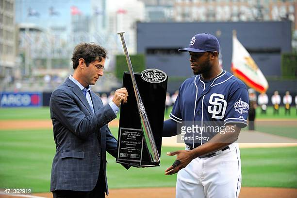 J Preller general manager of the San Diego Padres presents the Louisville Slugger Silver Slugger trophy to Justin Upton before a baseball game...