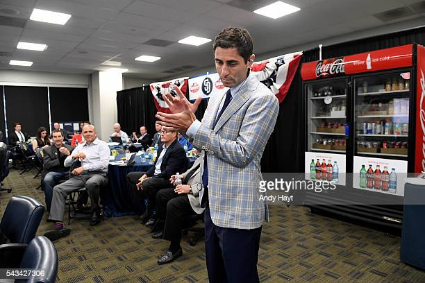 Preller of the San Diego Padres Baseball claps after the teams second selection in the first round in the 2016 MLB Amateur Draft at PETCO Park on...