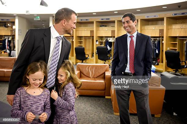 Preller of the San Diego Padres greets Andy Green and his family prior to the press conference introducing Green as the new Manager of the San Diego...