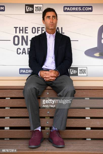 Preller of the San Diego Padres sits in the dugout prior to the game on Opening Day against the San Francisco Giants at Petco Park on April 7 2017 in...