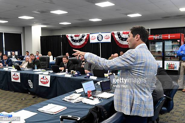 Preller of the San Diego Padres talks to members of the baseball operations staff during the 2016 MLB Amateur Draft at PETCO Park on June 9 2016 in...