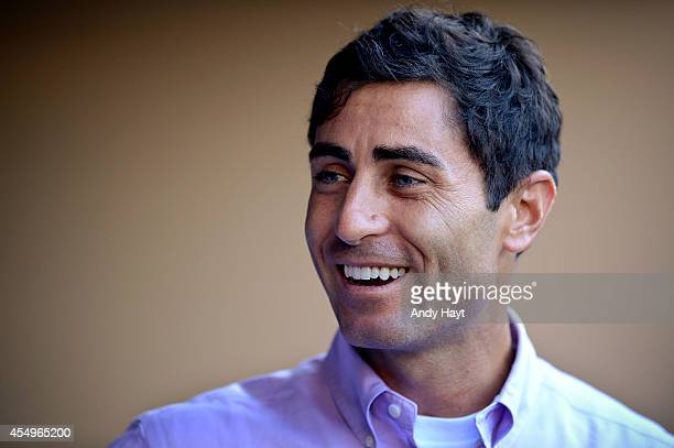 Preller of the San Diego Padres visits the dugout prior to the game against the Milwaukee Brewers at Petco Park on August 26 2014 in San Diego...