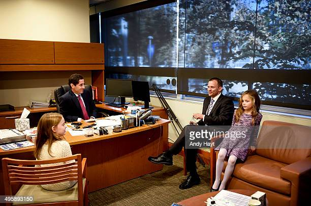 Preller of the San Diego Padres visits with Andy Green and family in his office prior to the press conference introducing Green as the new Manager of...