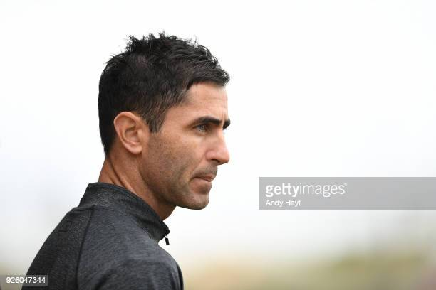 Preller of the San Diego Padres watches a workout at the Peoria Sports Complex on February 21 2018 in Peoria Arizona
