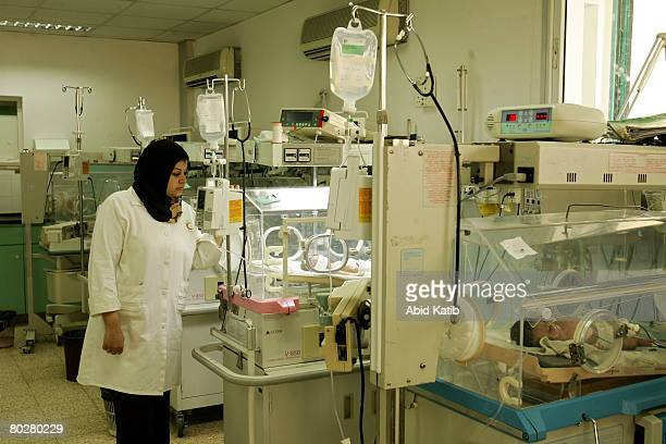 Premature Palestinian new born babies are cared for by the nurse Somayea Ayead at the prematurity department at the AlShifa hospital March 17 2008 in...