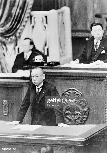 Premier Admiral Keisuke Okada pictured as he addressed the House of Peers during a session of the body in Tokyo is shown President Fumimaro Konoye of...